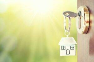 key chain with a new home in a door - HOME LOANS